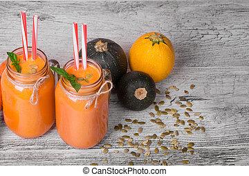 vista superior, de, um, smoothie, bebida, em, um, grande, pedreiro, jarro., refrescar, cenoura, bebida, com, três, abobrinhas, ligado, um, cinzento, experiência.