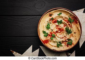 vista superior, de, um, tigela hummus, mergulho, e, pão pita, ligado, um, tabela, experiência., culinária oriental mediana, composition., cópia, space.