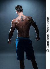 vista traseira, de, um, topless, atlético, homem, com, tatuagem