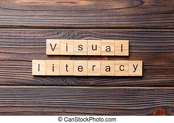 visual literacy word written on wood block. visual literacy text on cement table for your desing, concept
