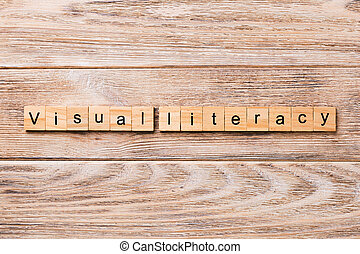 visual literacy word written on wood block. visual literacy text on wooden table for your desing, concept
