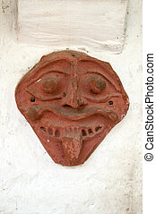 Vitage - A old clay mask typical of indian culture hung on a...