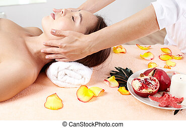 Massage therapist helping young woman accumulate energy after a workweek
