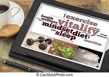 vitality or vital energy concept on a digital tablet, a collage of pictures and word cloud