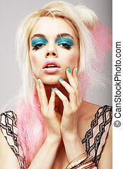 Vitality. Eccentric Blond with Theatrical Cyan Makeup. Dyed Pink Hair