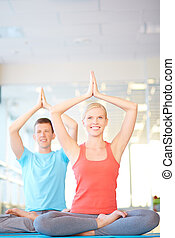 Vitality - Happy dates in activewear practicing yoga