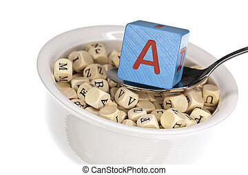 Vitamin-rich alphabet soup featuring vitamin a, isolated on a white background