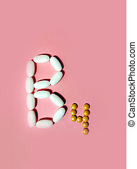 Vitamin B4 is laid out in tablets. choline. Photo top view. ...