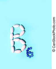 Vitamin B6 is laid out in tablets. pyridoxine Photo top view...