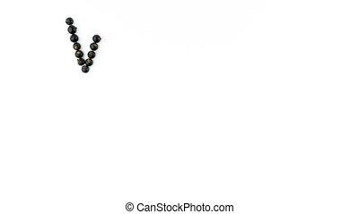 Vitamin C. Black currant berries on white background. 4K...