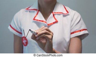 VITAMIN C, Female doctor writing on transparent screen -...