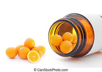 Vitamin C - Miniature oranges inside a vitamin pill ...