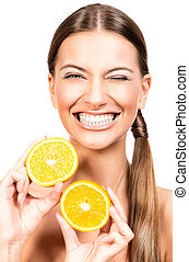 vitamin C - Pretty joyful young woman holding fresh juicy...