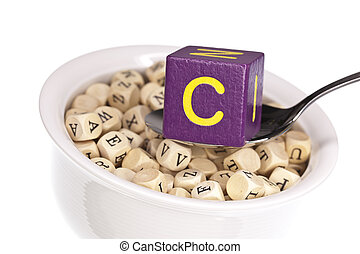 Vitamin-rich alphabet soup featuring vitamin c, isolated on a white background