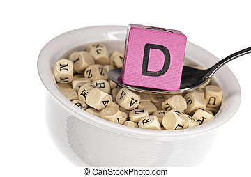 Vitamin-rich alphabet soup featuring vitamin d, isolated on a white background