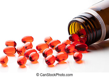 vitamin E capsules on white background