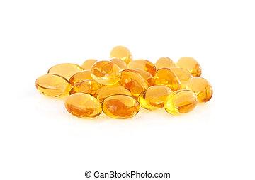 Vitamin E supplement capsules closeup on a white background