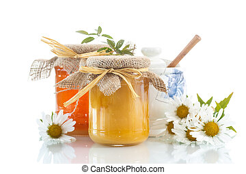 honey - vitamin fresh honey in glass jar on white background