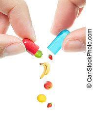 Vitamin pill - Fruit pouring out of an opened capsule