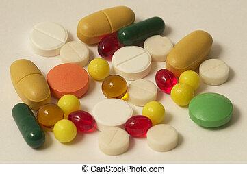 Vitamin pills - Colored glossy rounded multi vitamin pills ...