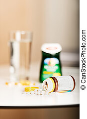 Vitamin pills on table