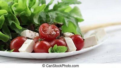 Vitamin salad from mozzarella, cherry tomatoes and lettuce....