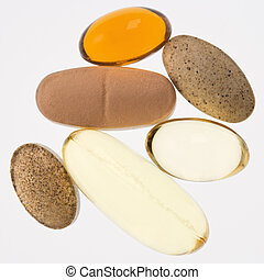 Vitamin supplements. - Close up of supplement vitamin pills ...