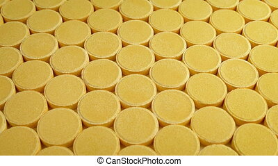 Vitamin Tablets Mass Production - Passing rows of vitamin...