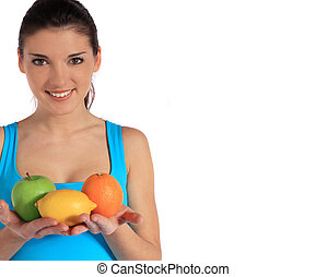 Attractive young woman holding various fruits. Extra text space on right side. All on white background.