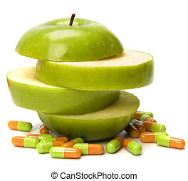 vitamins source - sliced apple and pills isolated on white ...