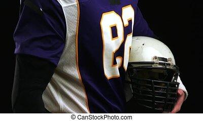 vitesse principale, football, contre, joueur, américain, arrière-plan noir, tenue