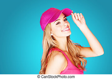 Vivacious beautiful blond woman in summer fashion wearing a...