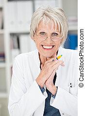 Vivacious beautiful senior businesswoman