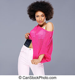 Vivacious chic African American woman with a wild afro...