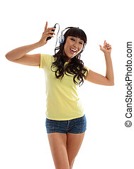 Vivacious girl listening to music and dancing