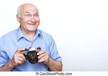 Vivacious grandfather holding camera - Crack a smile....
