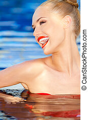 Vivacious laughing woman in water - Vivacious laughing woman...