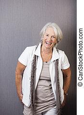 Vivacious trendy senior woman
