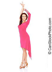 Vivacious woman dancing in a sexy pink dress
