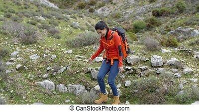 Vivacious woman enjoying a mountain hike - Vivacious...
