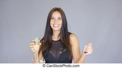 Vivacious woman having fun at a New Year party
