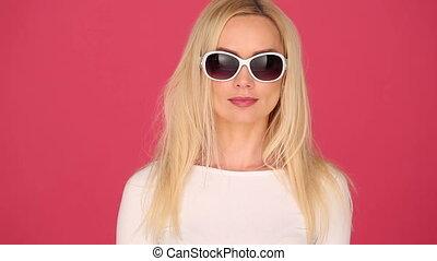 Vivacious woman in trendy sunglasses