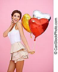 Vivacious woman with heart shaped balloons - Vivacious woman...