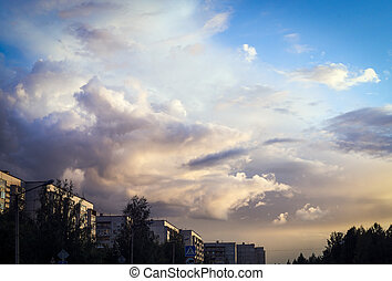 Vivid cloudy sky background in city