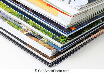 Vivid pages of catalogs on the table.