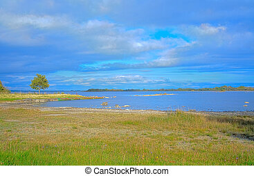 Lake Lough Corrib in one cloudy day. Co. Galway, Ireland.