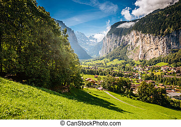 Vivid view of alpine village. Location place Swiss alps, Lauterbrunnen valley.