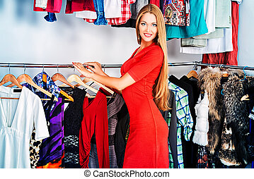Vivid woman - Fashionable girl shopping in a store.