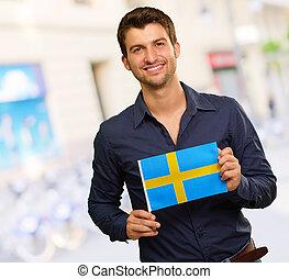 vlag, jonge, zweden, vasthouden, vrolijke , man