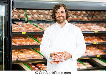 vlees, toonbank, vasthouden, pakketten, verkoper, vrolijke